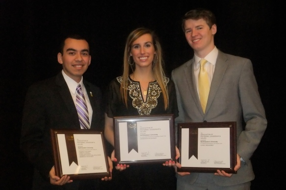 Presidents John Castellanos of the Multicultural Greek Council, Monika Buska of the Panhellenic Association, and John Cowgill of the Interfraternity Council holding the awards each council received at the Conference.
